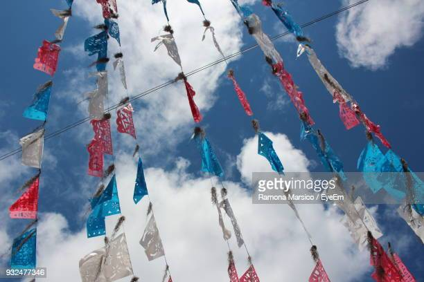 Low Angle View Of Buntings Hanging Against Sky