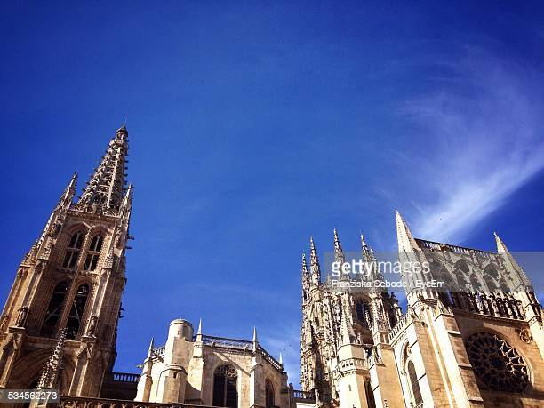 Low Angle View Of Burgos Cathedral Against Blue Sky