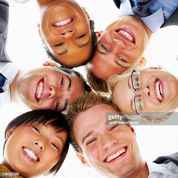 Low angle view of business colleagues smiling together