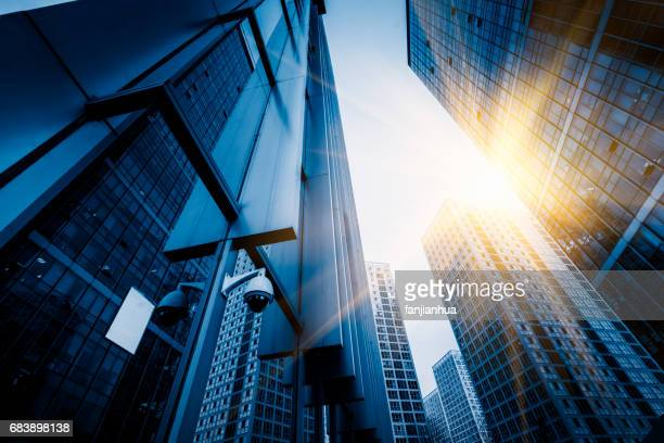 low angle view of business office buildings - business security camera stock pictures, royalty-free photos & images