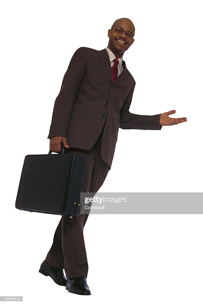 Low angle view of businessman with briefcase : Stockfoto