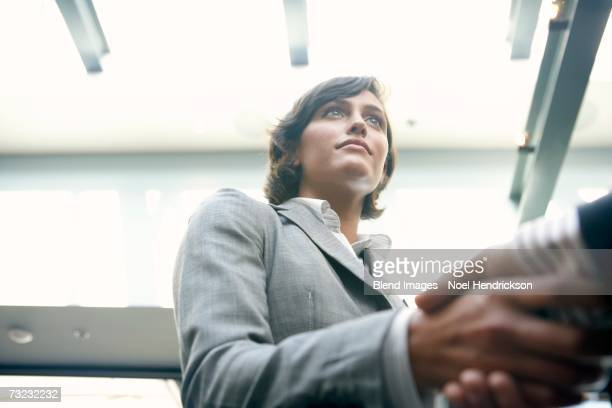 Low angle view of businesswoman shaking hands