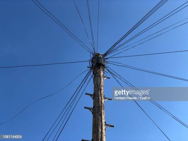 low angle view of cables against clear blue sky - wandsworth stock pictures, royalty-free photos & images