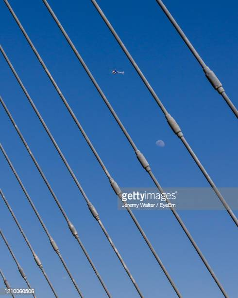 low angle view of cables against clear blue sky - eyeem jeremy walter stock pictures, royalty-free photos & images