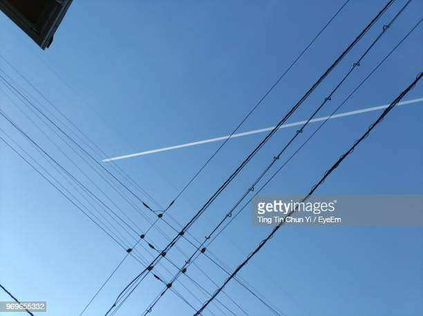 low angle view of cables against clear blue sky - 山口県 ストックフォトと画像