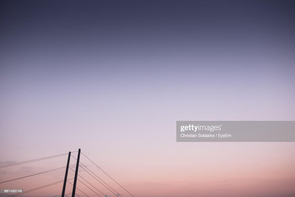 Low Angle View Of Cables Against Clear Sky During Sunset : Foto de stock