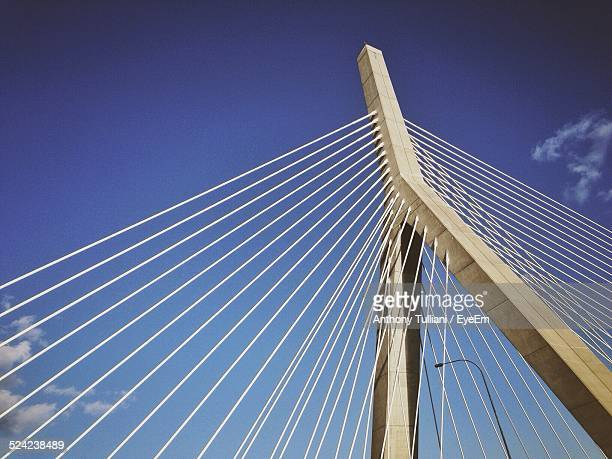 low angle view of cable-stayed bridge against blue sky - prop stock pictures, royalty-free photos & images