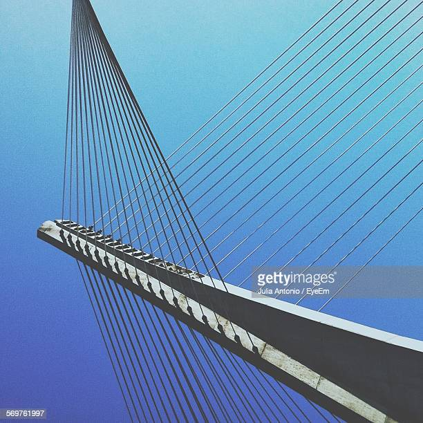 Low Angle View Of Cable-Stayed Bridge Against Clear Blue Sky