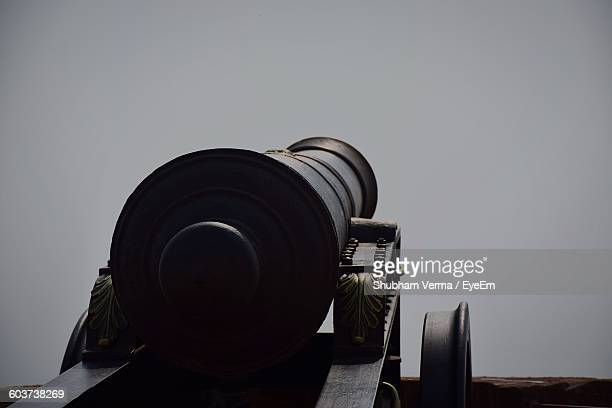 low angle view of cannon against clear sky - cannon stock pictures, royalty-free photos & images