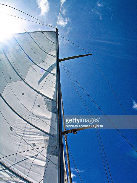 Low angle view of canvas sail against clear blue sky