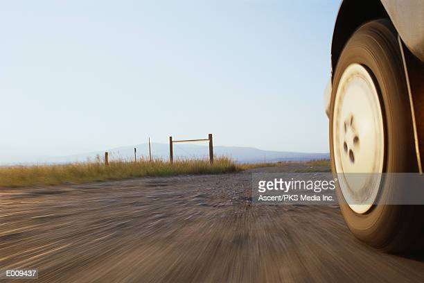 Low angle view of car on gravel road