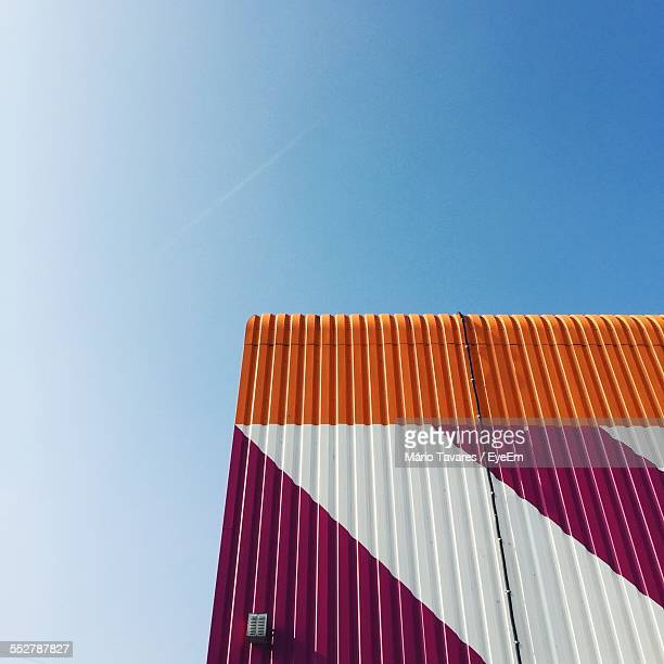 Low Angle View Of Cargo Container Against Clear Blue Sky