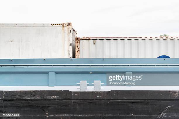 Low angle view of cargo containers at port