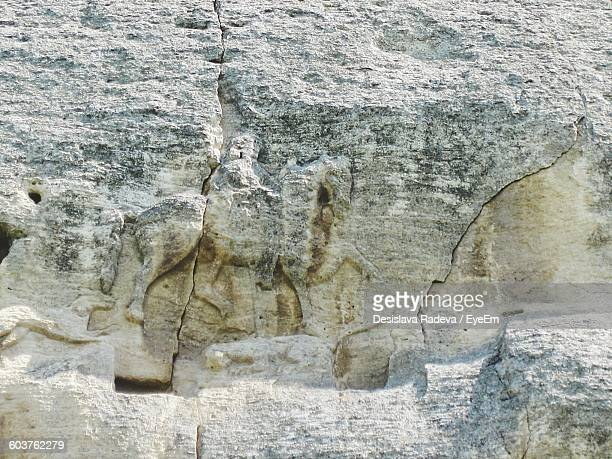 Low Angle View Of Carvings On Rock