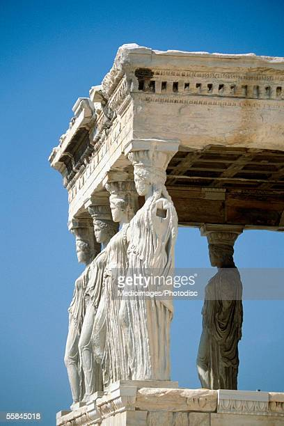 Low angle view of Caryatids, Acropolis Erecteion, Athens, Greece