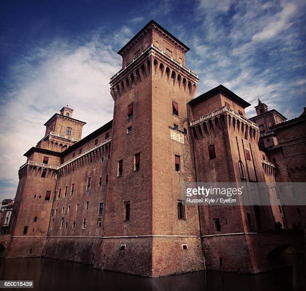 low angle view of castello estense against cloudy sky - ferrara foto e immagini stock