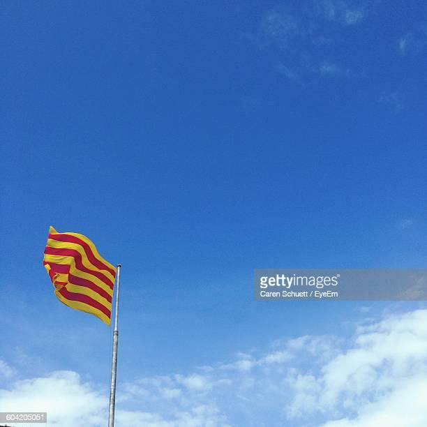 Low Angle View Of Catalonia Flag Against Sky