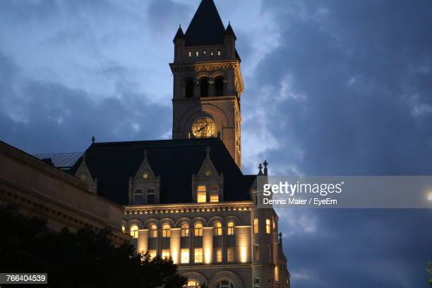 Low Angle View Of Cathedral Against Cloudy Sky At Night