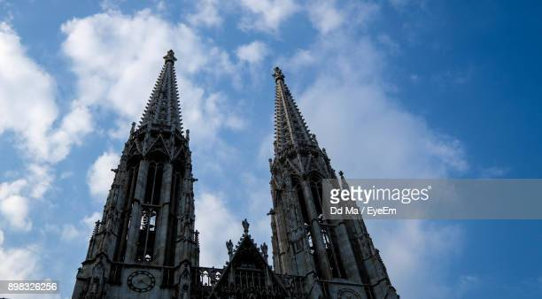 Low Angle View Of Cathedral Against Cloudy Sky
