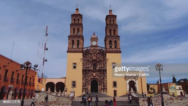 low angle view of cathedral against cloudy sky - dolores hidalgo stock pictures, royalty-free photos & images