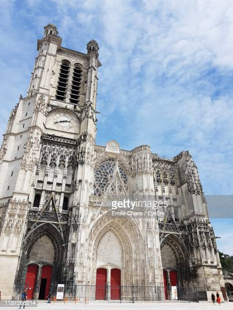 low angle view of cathedral against sky in city - troyes champagne ardenne photos et images de collection