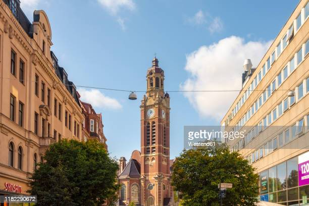 low angle view of cathedral against sky in city - malmo stock pictures, royalty-free photos & images
