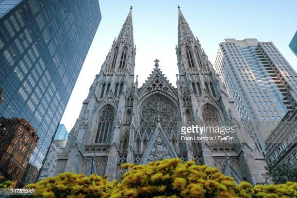 low angle view of cathedral against sky - katholicisme stockfoto's en -beelden