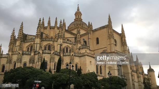 low angle view of cathedral against sky - segovia stock pictures, royalty-free photos & images