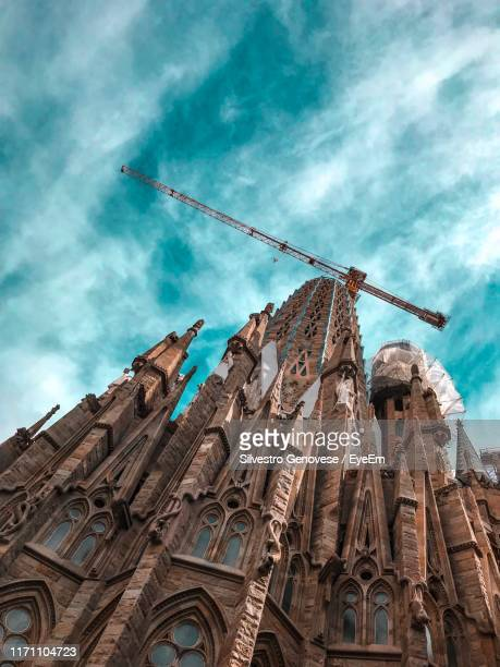 low angle view of cathedral against sky - basilica stock pictures, royalty-free photos & images