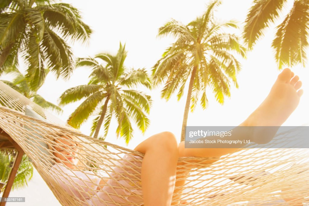 Low angle view of Caucasian woman laying in hammock : Foto stock