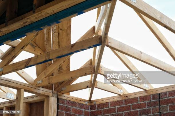 low angle view of ceiling structure of building - lara rafter stock pictures, royalty-free photos & images