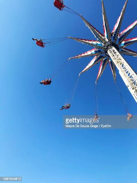 low angle view of chain swing ride against clear blue sky - ブルックリン コニー・アイランド ストックフォトと画像