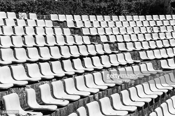 Low Angle View Of Chairs At Amphitheater