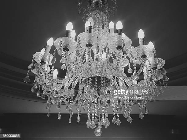 Low Angle View Of Chandelier Hanging On Ceiling At Home