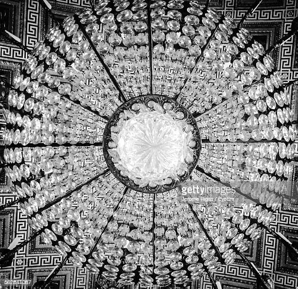 Low Angle View Of Chandelier On Ceiling Indoors