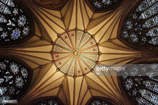 Low angle view of chapel ceiling and stained glass windows, York, UK