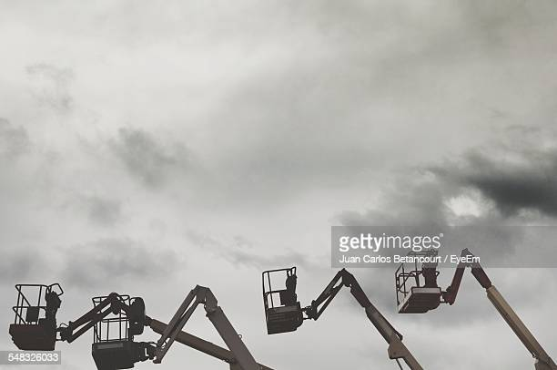 Low Angle View Of Cherry Pickers