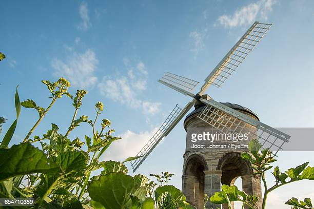 low angle view of chesterton windmill against sky - chesterton stock photos and pictures
