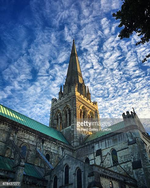 Low Angle View Of Chichester Cathedral Against Cloudy Sky