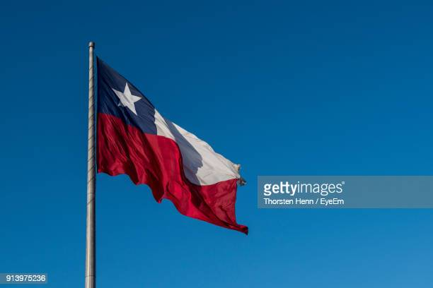 low angle view of chile flag against clear blue sky - bandera chilena fotografías e imágenes de stock