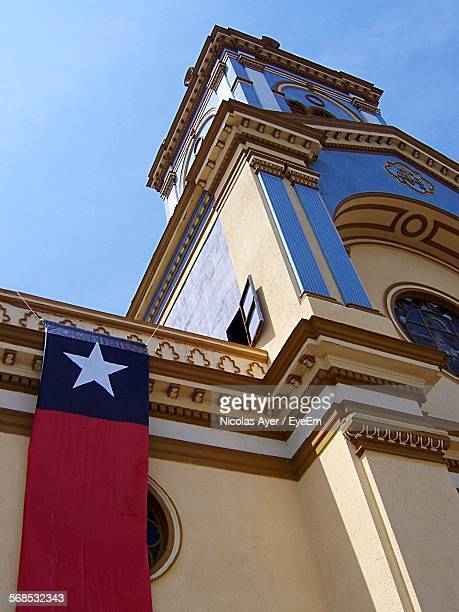 low angle view of chilean flag hanging on church wall - bandera chilena fotografías e imágenes de stock