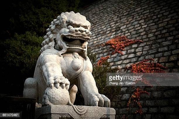 Low Angle View Of Chinese Dragon Against Wall