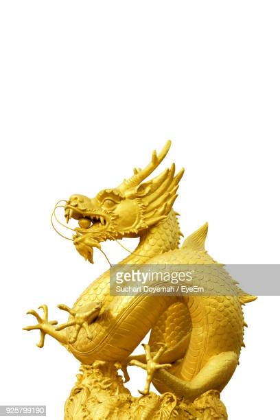 low angle view of chinese dragon against white background - chinese dragon stock photos and pictures