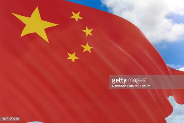low angle view of chinese flag against sky - chinese flag stock pictures, royalty-free photos & images