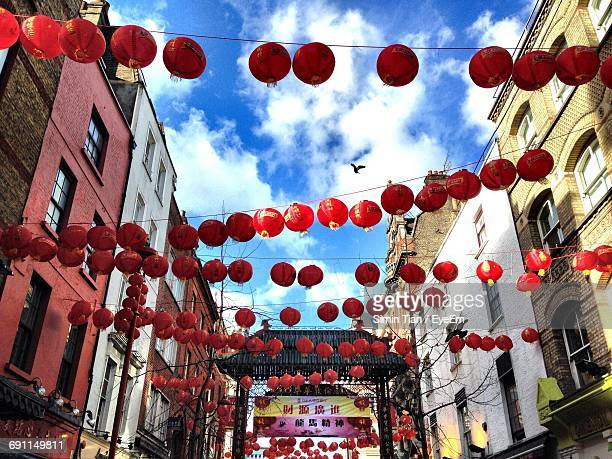 low angle view of chinese lanterns against sky - chinatown stock pictures, royalty-free photos & images