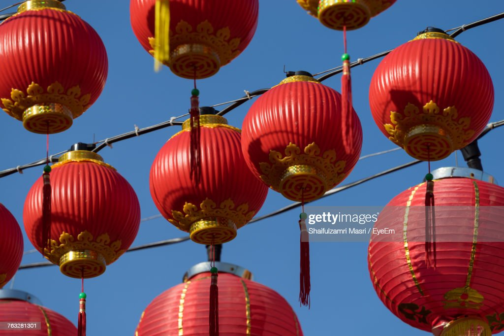 Low Angle View Of Chinese Lanterns Hanging Against Sky : Stock Photo