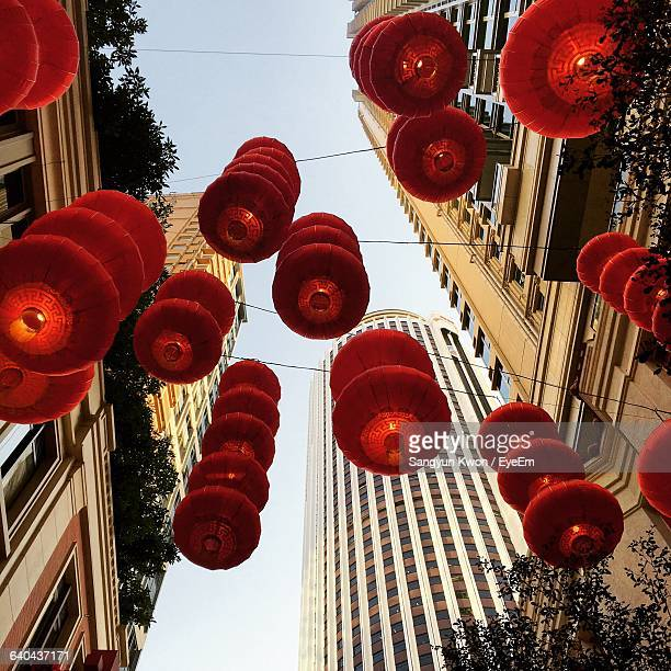 Low Angle View Of Chinese Lanterns Hanging Between Buildings
