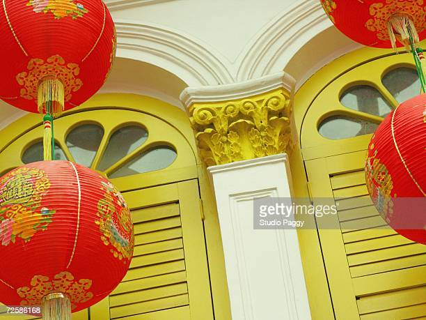 Low angle view of Chinese lanterns hanging in front of a door