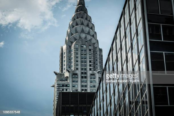 low angle view of chrysler building against sky - chrysler building stock pictures, royalty-free photos & images
