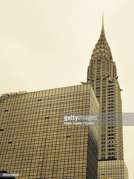 low angle view of chrysler building against sky - maria tejada stock pictures, royalty-free photos & images